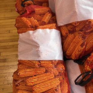 Image of bulk red netted bag of ears of corn