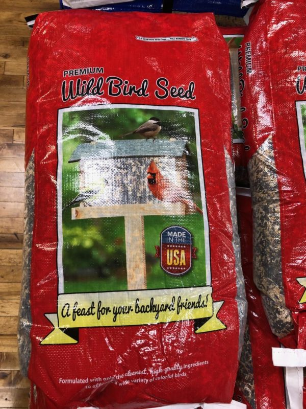 Photo of Elite Wild Bird Seed. Bag of seed is red with birdhouse and cardinal image superimposed on bag material.