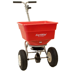 Photo of red Earthway Spreader, which looks like a frame with wheels attached to a bucket with a hole in the bottom for the lawn and garden.
