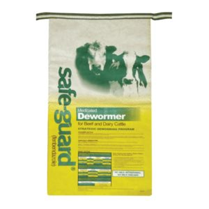 Photo of Safeguard (fenbendazole) 25 lb bag, a medicated dewormer for beef and dairy cattle. Bag is bright yellow with a white top and an image of two cows superimposed on white part.