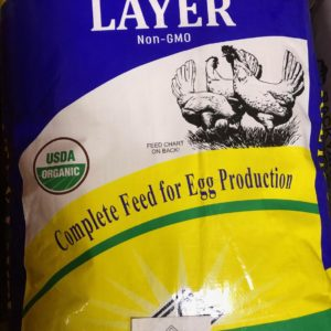 Photo of Certified Organic Chicken Layer. Packaging is blue, yellow, and green.